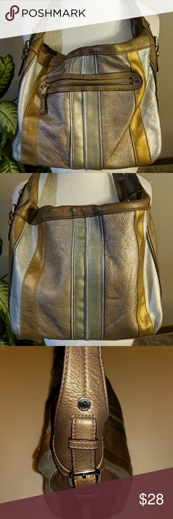 Tignanello large metallic shoulder bag Tignanello  metallic gold, silver, Light Beige , and a darker brown. Large purse. 12 in wide, 10 in high and 5 in wide. Great shape has a little wear on bottom corners has a zipper pocket on the outside cloth interior does have a few mark two pockets on the inside and another zipper pocket on the inside. Leather exterior. Tignanello Bags Shoulder Bags