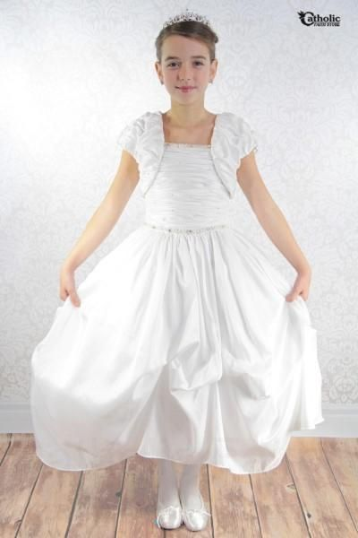 This plus size First Communion gown comes complete with a matching jacket! The sleveless taffeta ruched bodice adorned with scattered pearls.  Beautiful pearl and rhinestone trim adorn the dainty neckline and waistline. The back of the dress has a zipper closure. A glamorous puckered taffeta pick-up skirt completes this memorable First Communion look. Dress to impress as this stylish gown is sure to flatter any body shape!