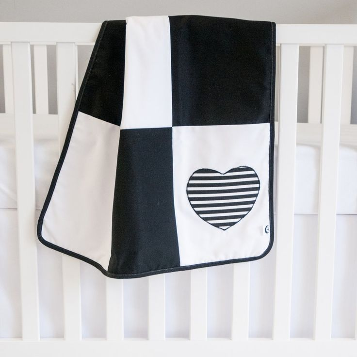 Black And White Nursery Ideas: Loving this black and white baby blanket with the striped heart pattern! This would be perfect for a modern or gender neutral nursery theme. #modernnursery #nurserydesign #nurserydecor #nurseryideas