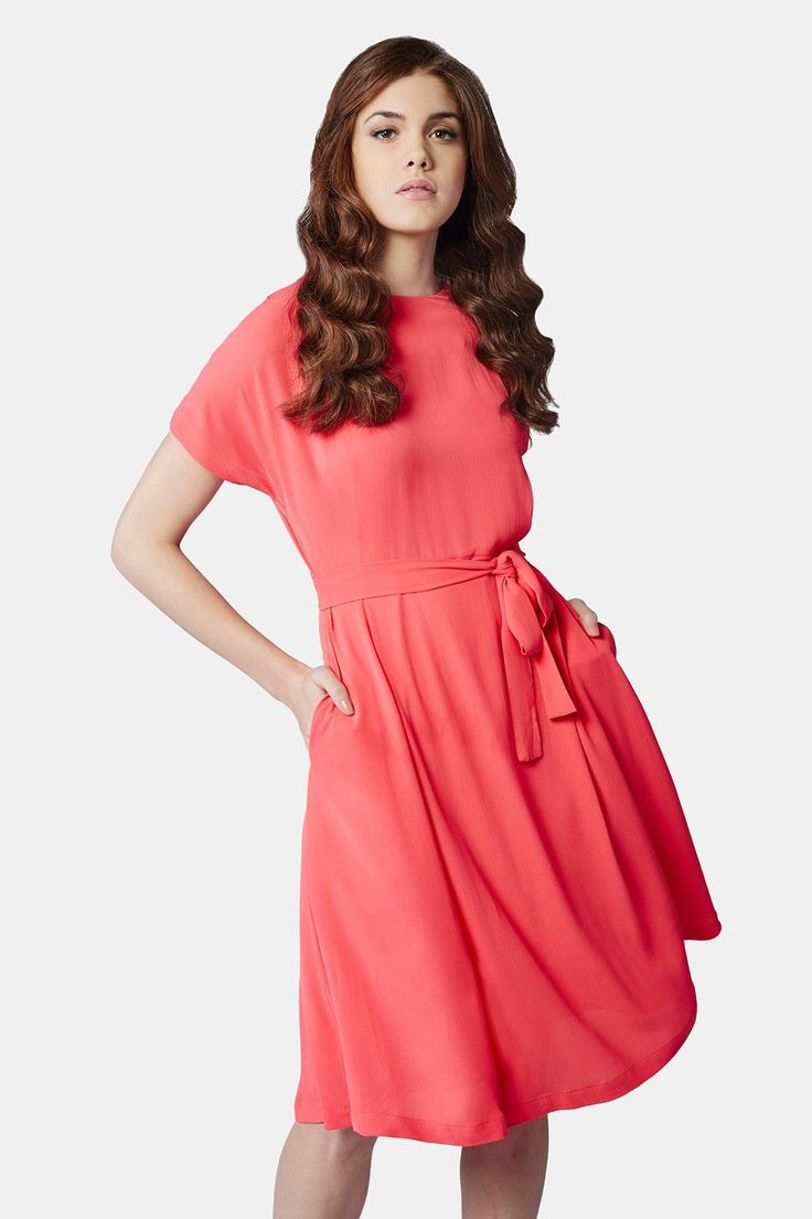 Featuring a round neck, extended shoulder sleeves, A-line dress with centre-back top button fastening and matching lining.