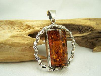 Unique amber pendant cognac stone.