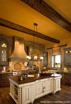 rustic feel is amazing..great wood beams and brick wall and floors with the cream island but personally would not choose yellow or the plaid curtains