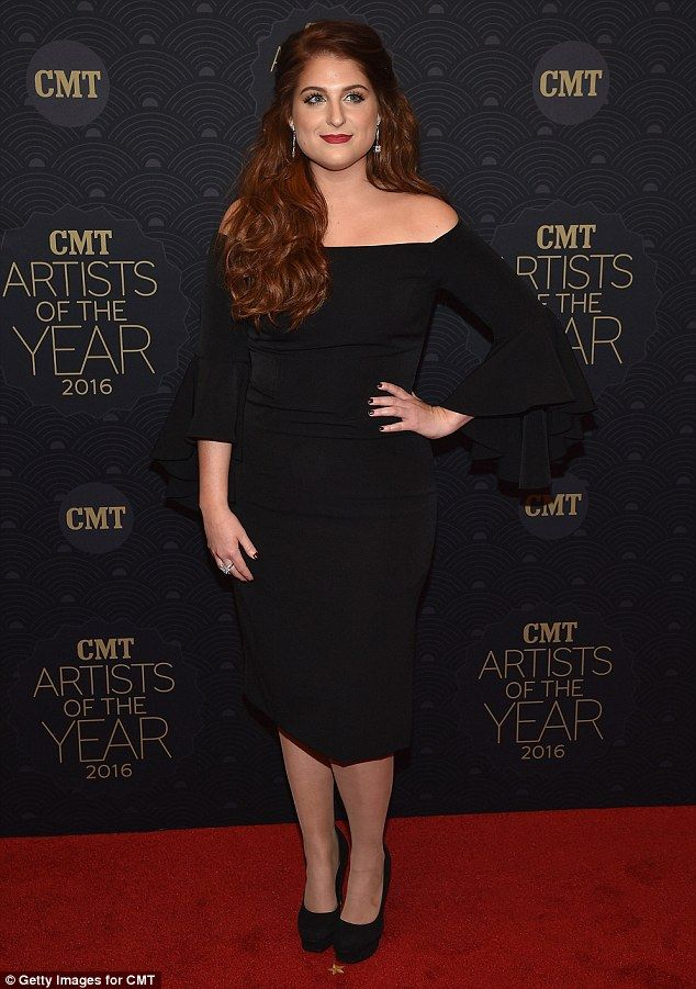 Contrast: Meghan Trainor elegantly clashed her red hair with her black skirt...
