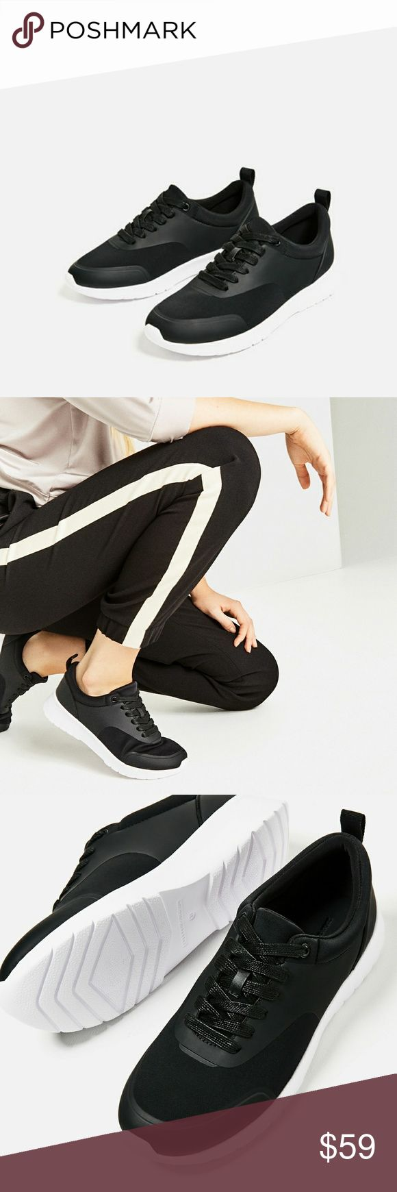 """Zara sneakers (6720) New with tag. EUR 38 US 7.5. Upper 70% Polyurethane thermoplastic 30% nylon. Lining 100% nylon. Sole 100% ethylene vinyl acetate. Slip sole 100% nylon.  Black sneakers. Contrasting matetial detail. Pull tab on the heel. Contrasting sole.  Height 3.5 cm/ 1.3"""" Zara Shoes Sneakers"""