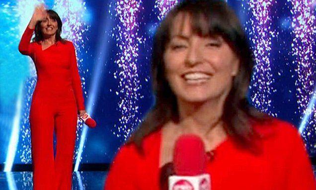 Davina McCall suffers wardrobe malfunction in skintight red catsuit