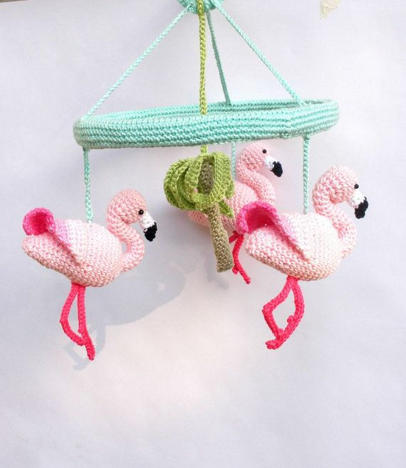 This cute Pink Flamingo Mobile will brighten up your baby girls nursery with its tropical colors. It features 3 crocheted pink flamingos and a green palm in the middle. This nursery mobile is handmade with love and care, using the best quality cotton yarn and an an-allergic stuffing. The wooden frame measures 20 cm (8 inches) diameter and is covered with aqua colored yarn. In the middle of it theres a little ring from which you can hang the mobile from the ceiling at the desired length. The…