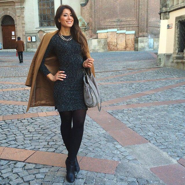 Mimi Ikonn | Camel coat, grey dress, black ankle boots
