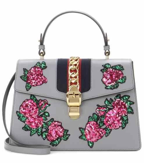 Sylvie leather handbag with appliqué | Gucci
