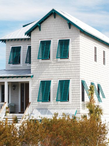 Bahama shutters on a white house; Try Caribbean Holiday 355-7 by Pittsburgh Paints & Stains® from Menards for a similar look.