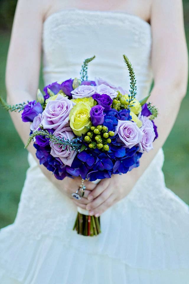 This bouquet of roses, hydrangeas and berries complimented the whimsical mood of this Tangled-inspired wedding #Disney #Disneyland #wedding #Tangled
