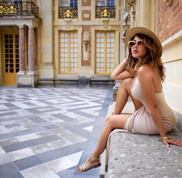 Adrienne Bailon sizzled in Versailles dressed in a nude tone frock and gold strappy sandals. Hot!