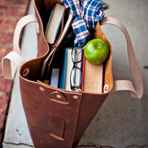 what my purse actually looks like. nothing but books and reading glasses.