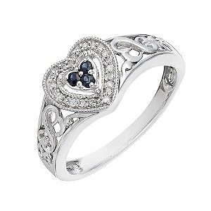 Get feminine sparkle with this stunning diamond and sapphire ring from Open Hearts by Jane Seymour. Set in sterling silver featuring Jane Seymour's intricate Open Hearts design in the shoulders, this ring showcases three sapphires at its centre and is finished with a heart shaped diamond surround. If your heart is open, love will always find its way in.