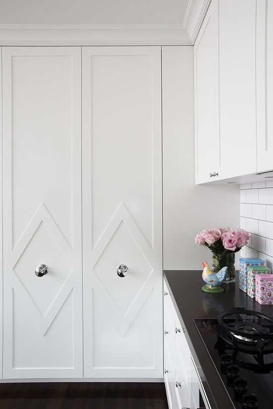 kitchen pull-out pantry doors with custom millwork + large knobs | via Instant Classics in Design ~ Cityhaüs Design