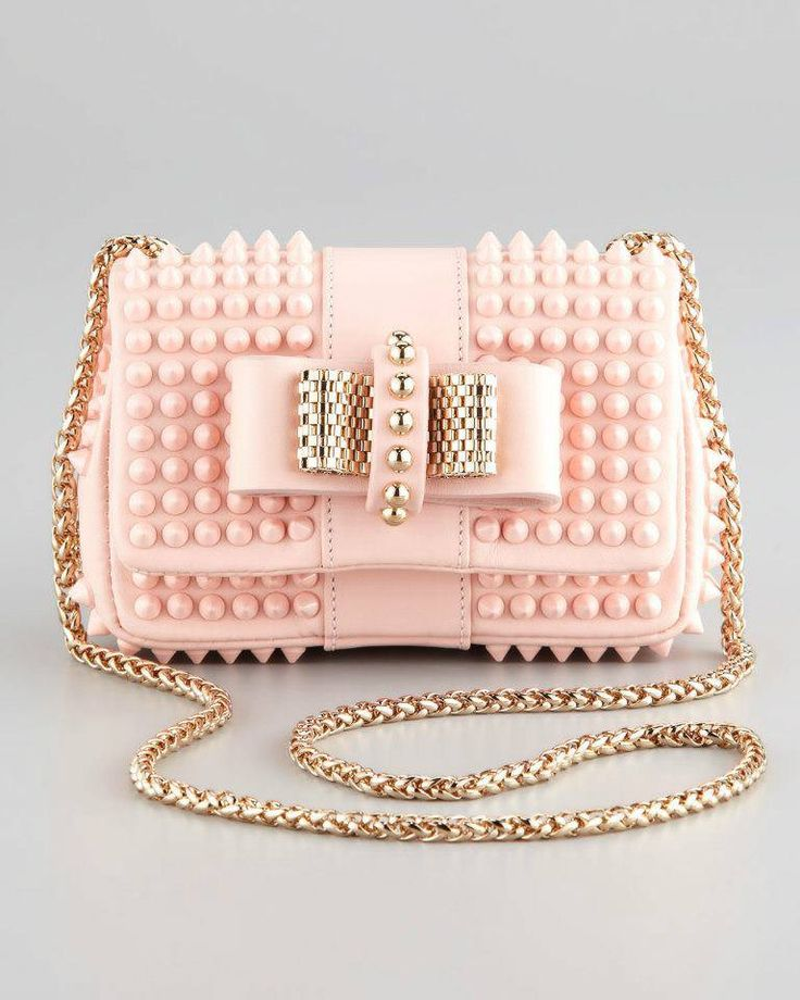 Add some edge to a sweet dress with this studded pink bag!