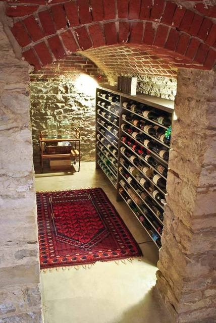 I want a stone wine cellar. I want it to come with wine. From Apartment Therapy
