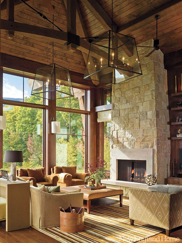 Great lanterns descend over a living room whose interior élan derives from the massive beams and fieldstone fireplace wall. Photo by Jim Westphalen