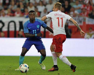 Quincy Promes and Kamil Grosicki. Poland v The Nederlands. Copyright B&O Press Photo.