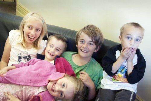 """Helping hands... AE Smith's Melbourne team is proud of its long association with """"the house that love built"""" - Ronald McDonald Houses in Monash and Parkville."""