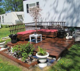 Pallets were used to build deck and make benches You could also use pallets for the deck rail and make a slightly raised flower bed, but they didn't