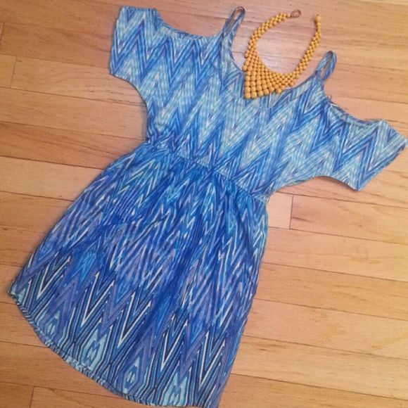 NEW Blue Chevron dress with cutout shoulders Silky and light with a stretchy waist to accommodate different sizes. Vibrant with blues, white, & a hint of purple. On trend with cutout shoulders. Brand new with tags. City Triangles Dresses