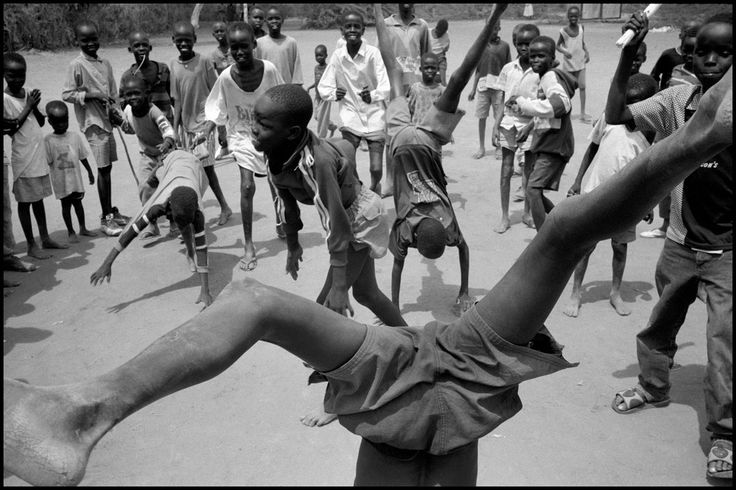 Eli Reed KENYA. Kakuma Refugee Camp. August 2001. Boys playing in the camp  Magnum Photos
