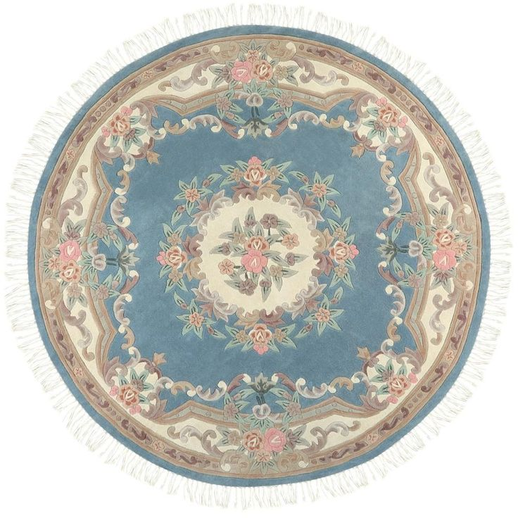 This 100% wool area rug comes in seven colors-- Wine, Black, Ivory, Light Blue, Light Green, Rose and Beige -- and three shapes: rectangle, oval and round.