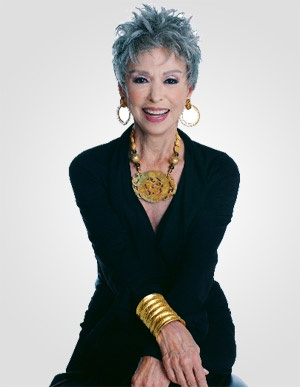 First, that hair is amazing. Second, the jewelry is fantastic with the simple dress. Third, what a great smile. Rita Moreno rocks.