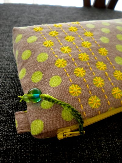 Sashiko embroidery on polka dot fabric. Handmade zipper pouch by Harujion Design