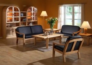 The photo shows: 1240 easy chair w/leather 40515 Royal 1240/2 2-seater sofa w/leather 40515 Royal 1240/3  3-seater sofa w/leather 40515 Royal 1511D coffee table 1511F end table 1511G end table 1190B wall unit combination