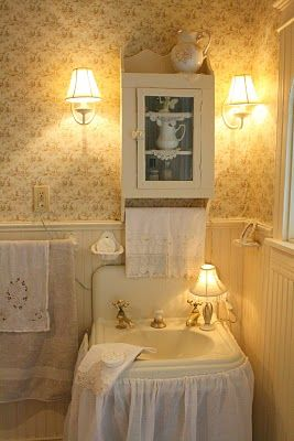 ♥ the lamp on the sink... I've always wanted to put a