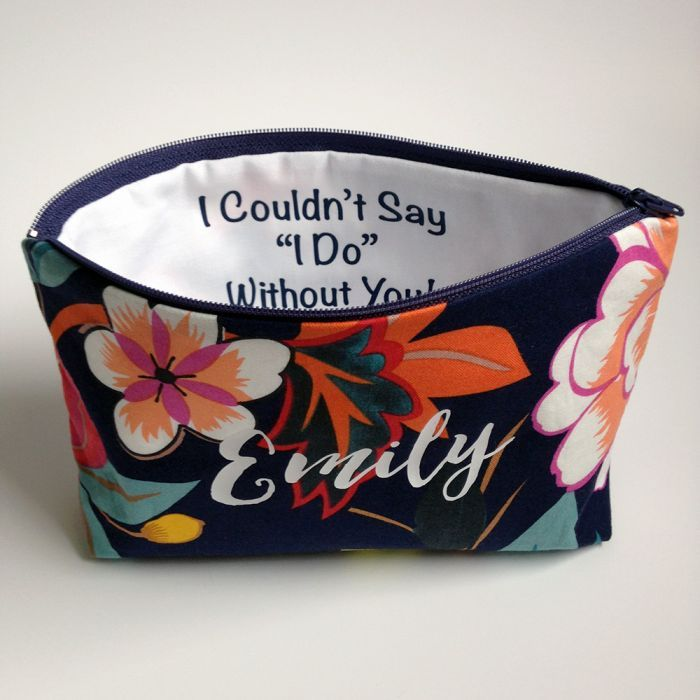 These tropical print cosmetic bags are a great gift for your bridesmaids. Add a name in our love script to the front of the bag and add a special note on the inside. Due to the nature of this fabric, the location of the flowers on the bags will vary.