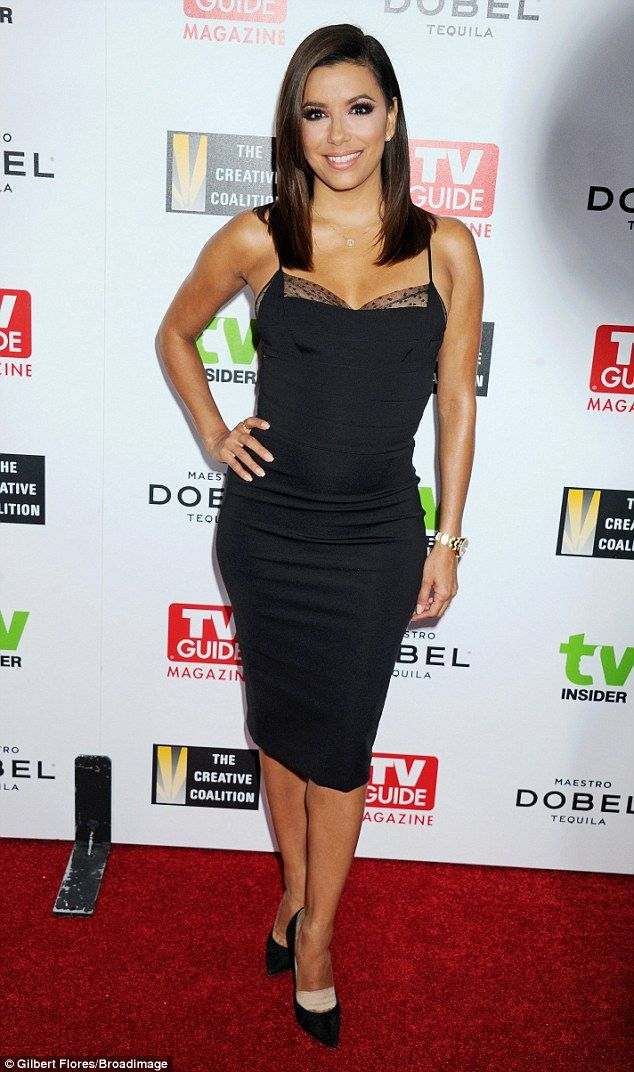 Rocking a little black dress:Eva Longoria poured her beautiful body into a figure-hugging...