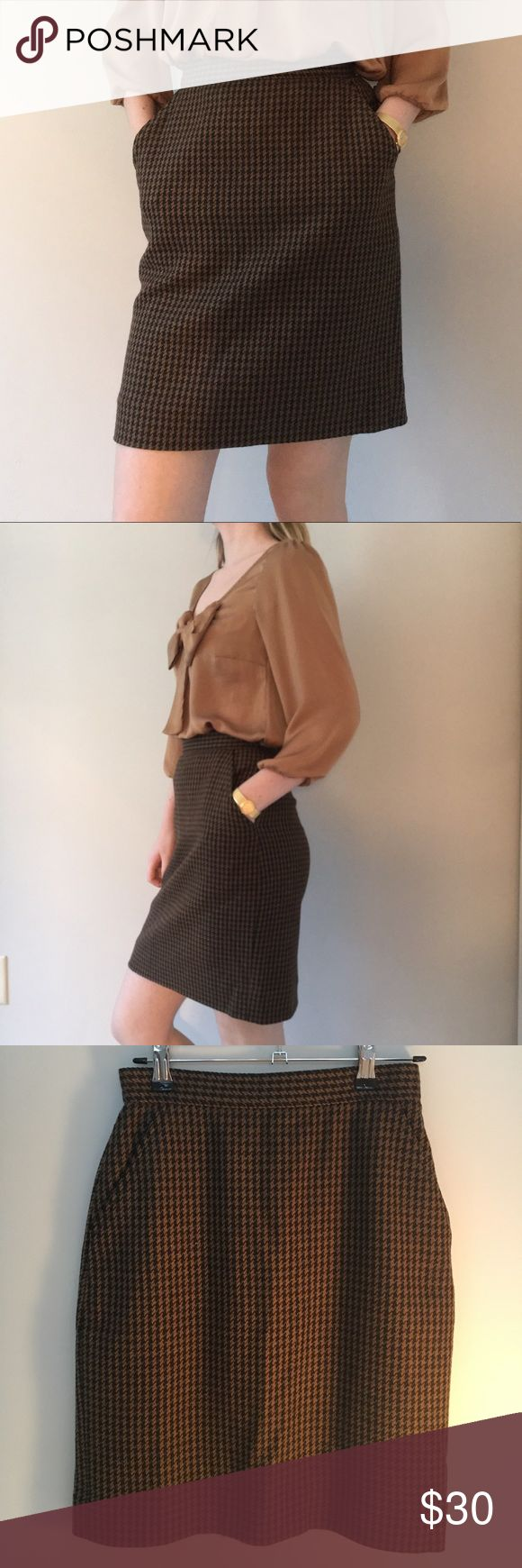 Calvin Klein Classic Wool Skirt Classic tweed skirt, beautiful vintage look to it! Silk inside so it feels great on the skin.  (It is labeled as a size 4, but runs very small so it is much more comfortable for a size 0 or 2) Calvin Klein Skirts Pencil