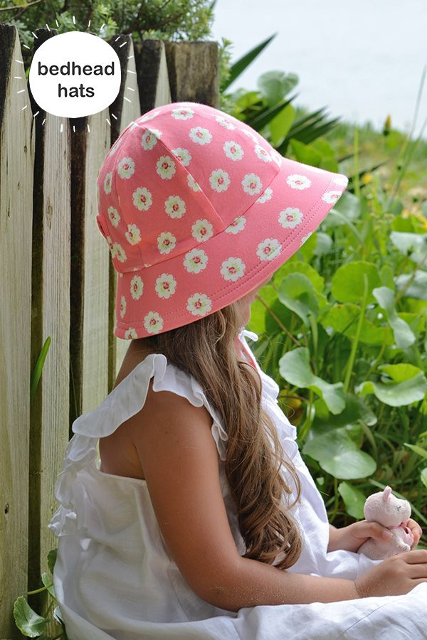 Bedhead's ponytail bucket hat in 'Olivia' rose print is perfect for Summer! #bedheadhats #kidshats #kidsfashion
