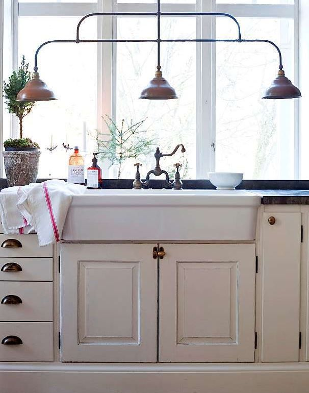 cream painted kitchen Scandinavian style, love the kitchen light over sink