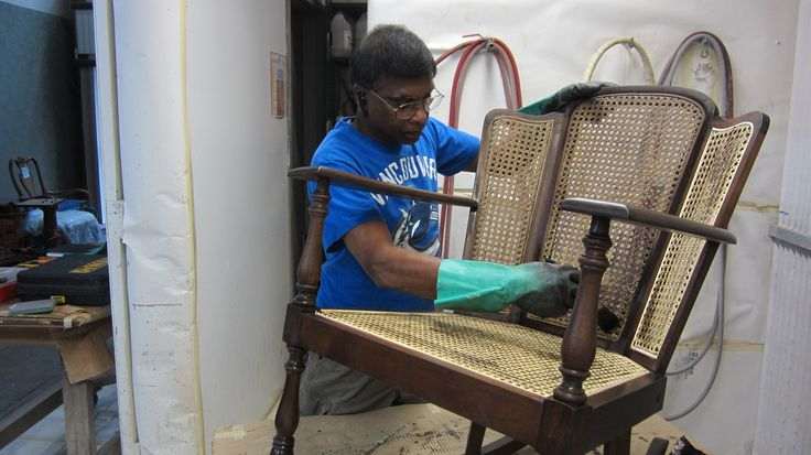 Staining the new cane of the rocking chair by AM Furniture Finishing.