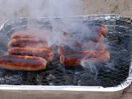 The distinctive smell of burnt sausages