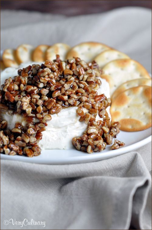 This easy French Quarter Cheese Spread topped with sugared pecans is the perfect sweet and salty combo, and makes a festive appetizer for holiday get togethers!