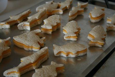 Grilled cheese fish shaped sandwiches done in the oven.