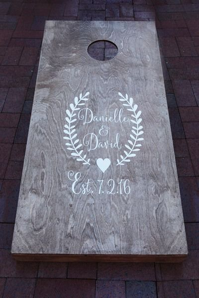 Wedding cocktail hour activity- wooden wedding corn hole board with couple's monogram and wedding date {Photography By Brittni Marie}