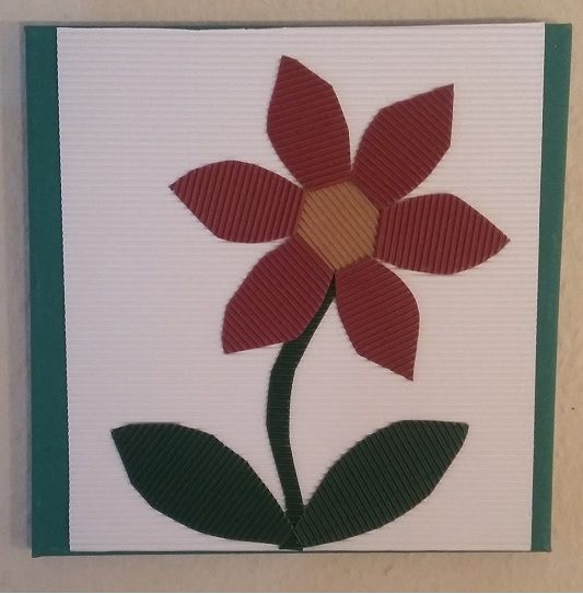 Flower picture made out of cardboard.