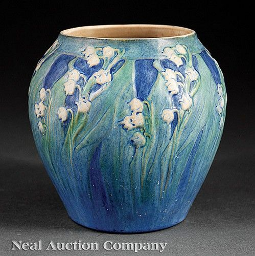 A Newcomb College Art Pottery Vase, 1930, decorated by Anna Frances Simpson with lilies-of-the-valley modeled in low relief, matte glaze with green, blue and white underglaze, base marked with Newcomb cipher, decorator's mark, Jonathan Hunt's potter's mark, reg. no. SK48 and shape no. 300, height 5 7/8 in