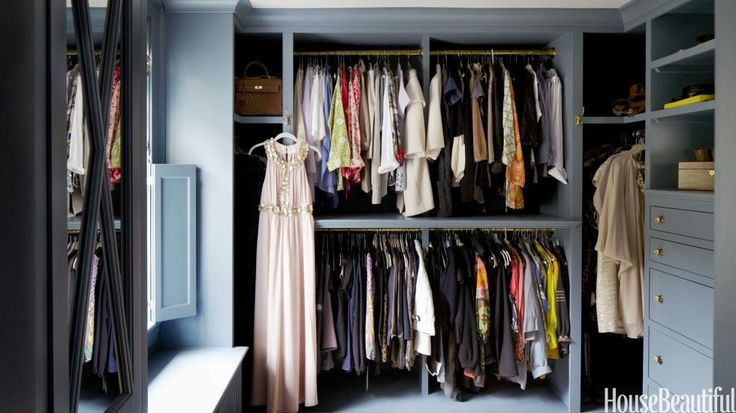 Instead of the usual chrome rods and white backdrop, Whitson gave her closet a more luxurious look by painting it Benjamin Moore's Blue Dusk and hanging her clothes on unlacquered brass rods.