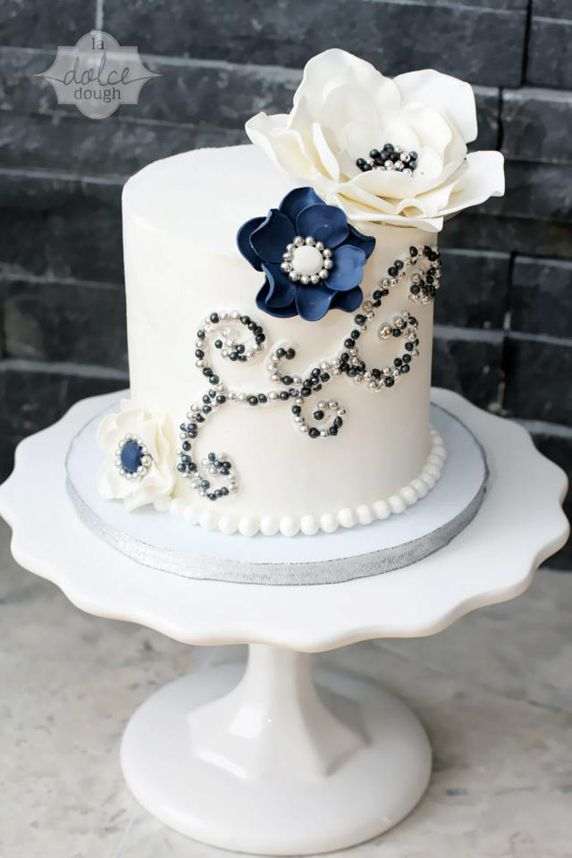 Pretty Jeweled White Cake. pretty when a wedding party doesn't need a huge cake.