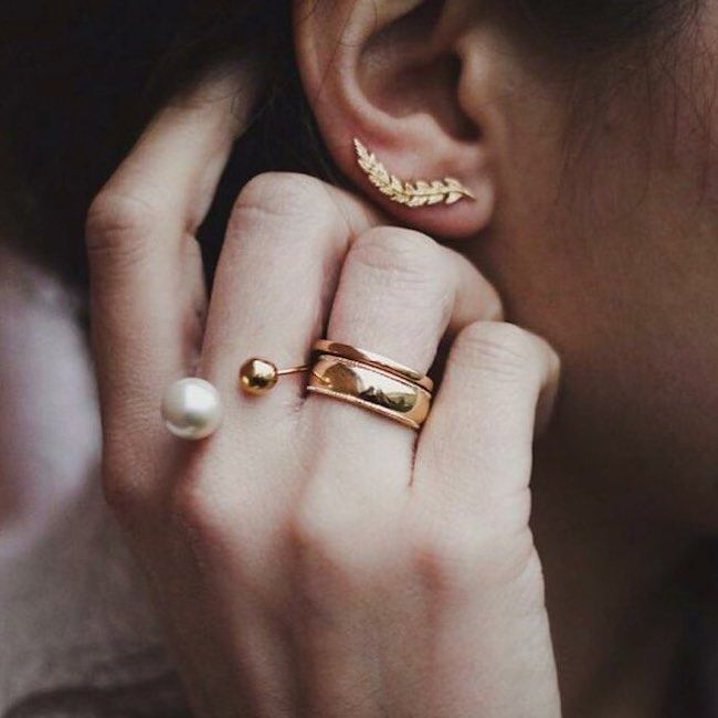 statement jewellery. gold rings and earrings with pearl added to the mix