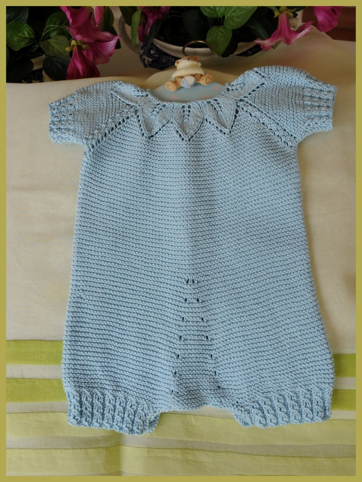 Inspiration photo. Garter stitch onesie, round leaf-patterned yoke. Crotch detail: shaped with eyelet increases (yo). Mock cable for ribbing.