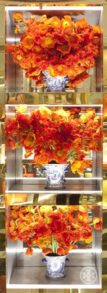 Orange poppies near a Madison Avenue boutique. Photo by Noa Griffel.