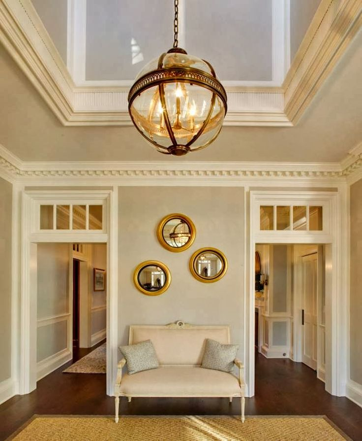 In an entrance to a home, it's the combination of a number of architectural details that together add up to create a total feeling. interior by APD Architects