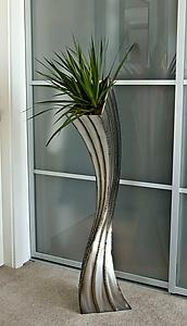 I love this Floor Planter by Michael Szabo. In fact, I love all of this artist's work!